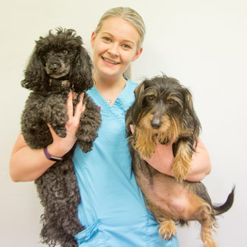 Emily Harrison holding two dogs.